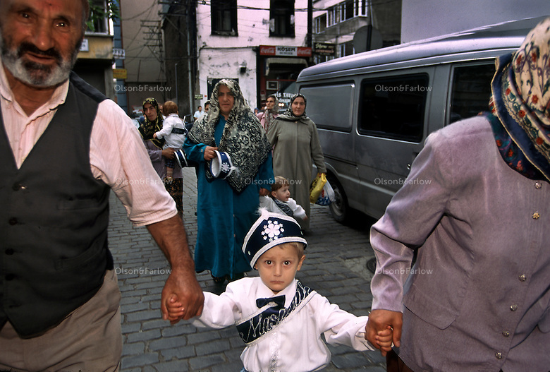 Circumcision Ceremony..Turkish housewives, angered by the influx of prostitutes and what their husbands were doing at night, created a fundamentalist Islamic movement in Trabzon...    The fundamentalist Islamic political party began circumcising 300 boys in the center of town to get support for their candidate...