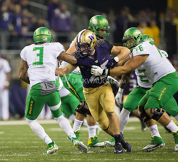 Ben Burr-Kirven gets into the backfield to take down Vernon Adams.