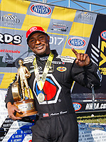 May 21, 2017; Topeka, KS, USA; NHRA top fuel driver Antron Brown celebrates after winning the Heartland Nationals at Heartland Park Topeka. Mandatory Credit: Mark J. Rebilas-USA TODAY Sports