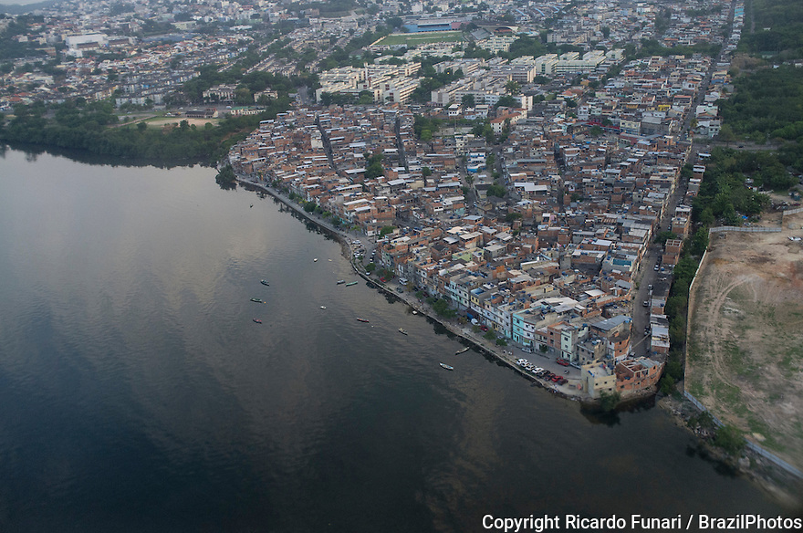 Aerial view of Guanabara bay at the border of Favela da Maré ( Mare slum ), Rio de Janeiro.