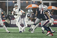 FOXBOROUGH, MA - NOVEMBER 24: Dallas Cowboys Quarterback Dak Prescott #4 looks down the field for a target during a game between Dallas Cowboys and New England Patriots at Gillettes on November 24, 2019 in Foxborough, Massachusetts.