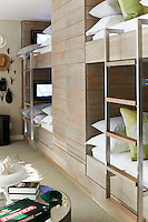 Two sets of bunk beds in a children's bedroom. Each of the bunk beds has its own flat screen viewing consol with headphones, a child's dream.