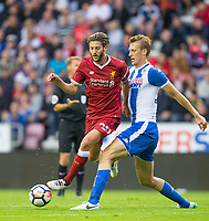 Dan Burn of Wigan Athletic and Adam Lallana of Liverpool during the pre season friendly match between Wigan Athletic and Liverpool at the DW Stadium, Wigan, England on 14 July 2017. Photo by Andy Rowland.