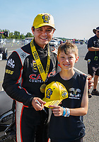 Jun 11, 2017; Englishtown , NJ, USA; NHRA top fuel driver Steve Torrence celebrates with a fan after winning the Summernationals at Old Bridge Township Raceway Park. Mandatory Credit: Mark J. Rebilas-USA TODAY Sports