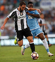 Calcio, Serie A: Lazio vs Juventus. Roma, stadio Olimpico, 27 agosto 2016.<br /> Juventus&rsquo; Gonzalo Higuain, left, is challenged by Lazio's  Bastos during the Serie A soccer match between Lazio and Juventus, at Rome's Olympic stadium, 27 August 2016. Juventus won 1-0.<br /> UPDATE IMAGES PRESS/Isabella Bonotto
