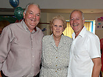 Rose Caffrey celebrating her 90th birthday with sons John and Dermot. Photo:Colin Bell/pressphotos.ie