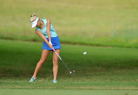 NWA Democrat-Gazette/MICHAEL WOODS &bull; @NWAMICHAELW<br /> Harbor golfer Joanna Keck chips onto the green during Har-Ber's golf match against Bentonville Tuesday August 18, 2015, at the Berksdale Golf Course in Bella Vista.