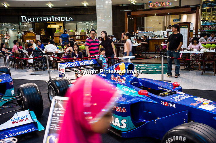 Shoppers seen at the Pavilion, a high end shopping mall in Kuala Lumpur, Malaysia. Photo: Sanjot Das/Panos