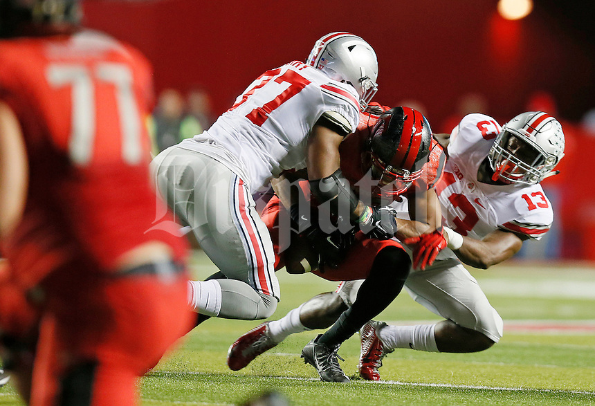 Ohio State Buckeyes cornerback Eli Apple (13) and Ohio State Buckeyes linebacker Joshua Perry (37) take down a Rutgers Scarlet Knight ball carrier during the college football game between the Rutgers Scarlet Knights and the Ohio State Buckeyes at High Point Solutions Stadium in Piscataway, NJ, Saturday night, October 24, 2015. The Ohio State Buckeyes defeated the Rutgers Scarlet Knights 49 - 7. (The Columbus Dispatch / Eamon Queeney)