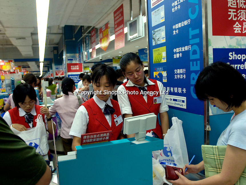 Cash desk of Carrefour supermarket in Beijing, China. Major international chains like Carrefour and Walmart Stores have expanded aggressively in China. Local Chinese retailers have loudly protested this and lobbied heavily for protection from the new competition in price and service that these major retailers have set off..23 Jul 2006