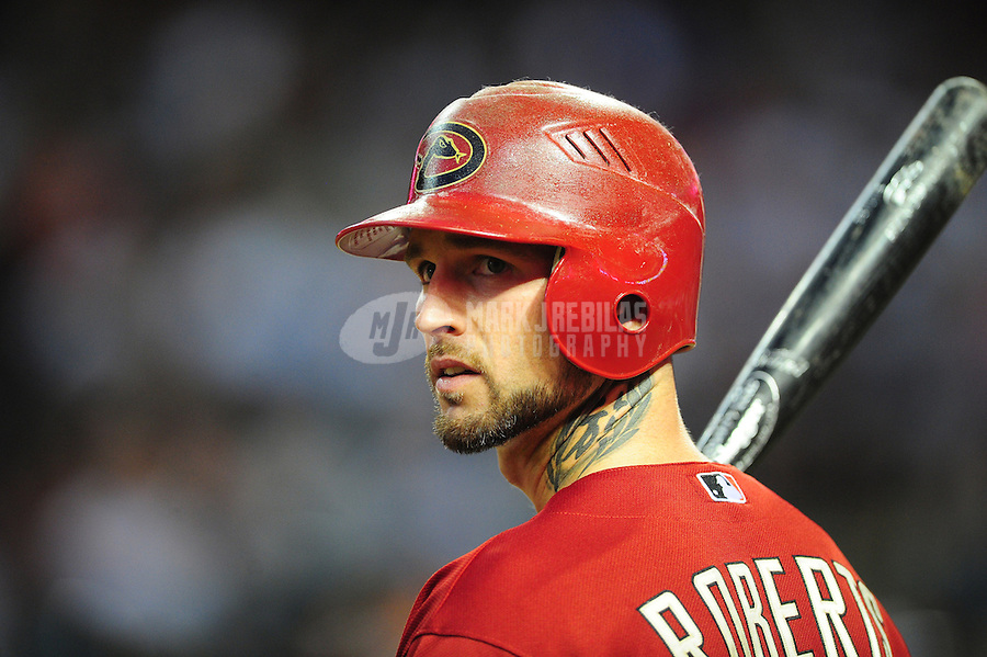 Jun. 15, 2011; Phoenix, AZ, USA; Arizona Diamondbacks batter Ryan Roberts in the on deck circle in the fourth inning against the San Francisco Giants at Chase Field. Mandatory Credit: Mark J. Rebilas-