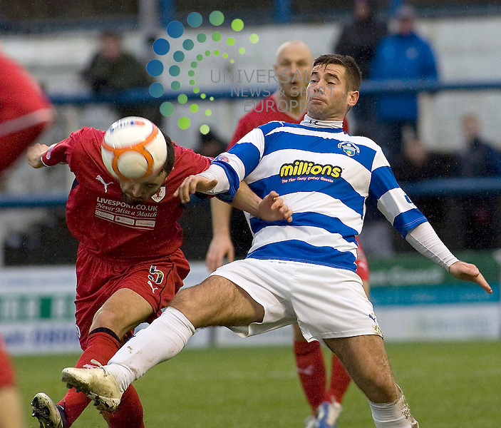 peter Macdonald((9) of Greenock Morton and Laurie Ellis (5)of Raith Rovers challenge for the ball during the Greenock Morton V Raith Rovers  Irn Bru Scottish First Division Match 2012-2013 at Cappielow Park, Greenock  .Picture: Campbell Skinner/Universal News And Sport (Scotland) 26th January 2013..