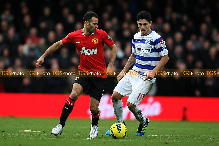 Ryan Giggs (Manchester United)  and Alejandro Faurlin (QPR)- QPR vs Manchester United - Barclays Premier League Football at Loftus Road, London - 18/12/11 - MANDATORY CREDIT: George Phillipou/TGSPHOTO - Self billing applies where appropriate - 0845 094 6026 - contact@tgsphoto.co.uk - NO UNPAID USE.