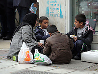 Pictured L-R: Afghan widow and mother of five Karima, 35 with three of her children, Samar, 5 and Fahad, 7 and Saud, 9 eat at a street corner Tuesday 08 March 2016<br />