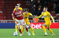Middlesbrough's Jonathan Howson gets away from Preston North End's Ben Pearson and Alan Browne<br /> <br /> Photographer Alex Dodd/CameraSport<br /> <br /> The EFL Sky Bet Championship - Middlesbrough v Preston North End - Tuesday 1st October 2019  - Riverside Stadium - Middlesbrough<br /> <br /> World Copyright © 2019 CameraSport. All rights reserved. 43 Linden Ave. Countesthorpe. Leicester. England. LE8 5PG - Tel: +44 (0) 116 277 4147 - admin@camerasport.com - www.camerasport.com