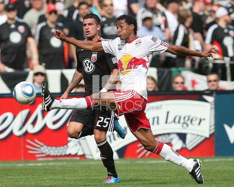 Santino Quaranta #25 of D.C. United watches Roy Miller #7 of the New York Red Bulls stretch out for the ball during an MLS match on May 1 2010, at RFK Stadium in Washington D.C.