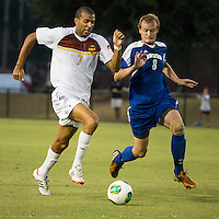 Winthrop University Eagles vs the Brevard College Tornados at Eagle's Field in Rock Hill, SC.  The Eagles beat the Tornados 6-0. Achille Obougou (7), and Garrett Stone (8) vie for the ball.