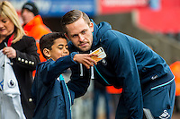 Gylfi Sigurdsson of Swansea City takes a selfie with a young fan ahead of the English Premier League game between Arsenal and Swansea at the Liberty Stadium in Swansea ,Wales, UK. Saturday 14 January 2017