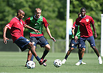 12 May 2006: Eddie Pope (l) plays the ball as Jimmy Conrad (in green) and Eddie Johnson (r) watch. The United States' Men's National Team trained at SAS Soccer Park in Cary, NC, in preparation for the 2006 FIFA World Cup tournament to be played in Germany from June 9 through July 9, 2006.