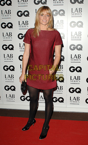 GABBY LOGAN.The GQ Man Of The Year Awards 2007, Royal Opera House, London, England..September 4th, 2007.full length red dress black tights hand in pocket clutch purse burgundy maroon gaby.CAP/ BEL.©Tom Belcher/Capital Pictures.
