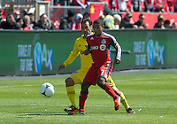 31 March 2011:Toronto FC forward Joao Plata #7 and Columbus Crew defender Sebastian Miranda #21 in action during a game between the Columbus Crew and the Toronto FC at BMO Field in Toronto, Ontario Canada.