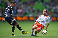 MELBOURNE, AUSTRALIA - SEPTEMBER 12, 2010: Ricardinho from the Victory beats Massimo Murdocca from the Roar in Round 6 of the 2010 A-League between the Melbourne Victory and Brisbane Roar at AAMI Park on September 12, 2010 in Melbourne, Australia. (Photo by Sydney Low / Asterisk Images)