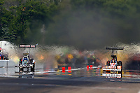 Aug. 18, 2013; Brainerd, MN, USA: NHRA top fuel dragster driver Terry McMillen (left) races alongside Clay Millican during the Lucas Oil Nationals at Brainerd International Raceway. Mandatory Credit: Mark J. Rebilas-