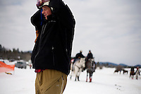 Competitors ready their ski and horse equipment in preparation for racing at the Whitefish Skijoring World Championship event in Whitefish, Montana, USA.  Skijoring is a competitive sport in which a person on skis navigates an obstacle course while being pulled behind a galloping horse.