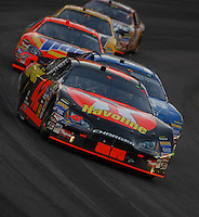 Apr 22, 2006; Phoenix, AZ, USA; Nascar Nextel Cup driver Casey Mears of the (42) Texaco Havoline Dodge Charger leads a pack of cars during the Subway Fresh 500 at Phoenix International Raceway. Mandatory Credit: Mark J. Rebilas-US PRESSWIRE Copyright © 2006 Mark J. Rebilas..