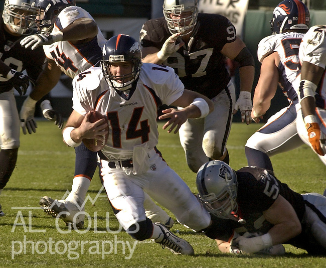 5192960f4 Oakland Raiders linebacker Bill Romanowski (53) sacks Denver Broncos  quarterback Brian Griese (14
