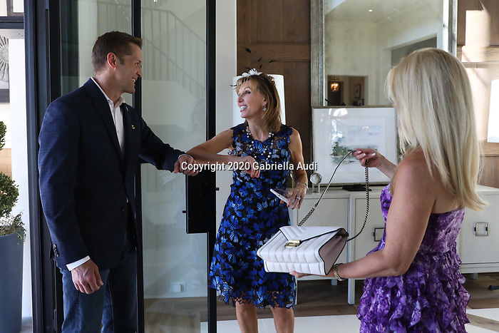 June 20, 2020: Patti Reeves greets guests with an elbow bump during the watch party she is hosting for her horse, Sole Volante. Gabriella Audi/Eclipse Sportswire/CSM