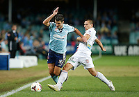 Sydney FC Terry Antonis (L) fights for the ball with Perth Glory Nebojsa Marinkovic during their A-League match in Sydney, April 13, 2014. Photo by Daniel Munoz/VIEWPRESS EDITORIAL USE ONLY