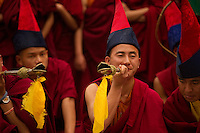 Buddhist Monks playing musical instruments in a Losar ceremony, Sikkim, India