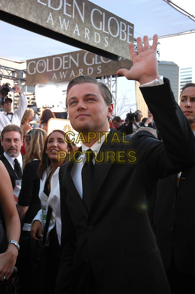 LEONARDO DICAPRIO.62nd Annual Golden Globe Awards, Beverly Hills, Los Angeles, California.January 16th, 2005.half length, black suit jacket, waving, gesture.www.capitalpictures.com.sales@capitalpictures.com.Supplied by Capital Pictures.