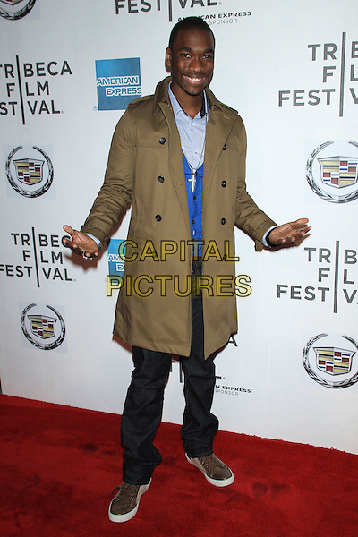 "Jay Pharoah.The 2012 Tribeca Film Festival World Premiere of ""Lola Versus"" at the Tribeca Performing Arts Center, New York, NY, USA..April 24th, 2012.full length brown coat hands arms jeans denim.CAP/LNC/TOM.©LNC/Capital Pictures."