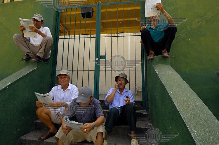 Punters at Ho Chi Minh race track (Saigon Racing Club).