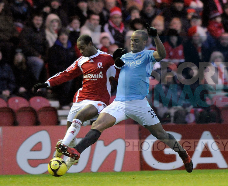 Middlesbrough's Justin Hoyte and Manchester City's Nigel De Jong.