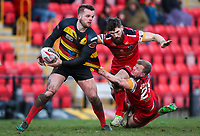 Picture by Alex Whitehead/SWpix.com - 11/02/2018 - Rugby League - Betfred Championship - Dewsbury Rams vs London Broncos - Tetleys Stadium, Dewsbury, England - Dewsbury's Aaron Brown is tackled by London's Jarrod Sammut and Jordan Johnstone.