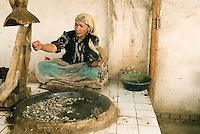 The remote city of Hotan (Khotan) in China's Xinjiang Uyghur Autonomous Region was an important oasis town along the ancient Silk Road. While silk is manufactured on a mass scale in China, Uyghur women still carefully reel the strands from boiling cocoons of silk worms in a traditional silk workshop in Hotan (Khotan)..
