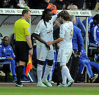 (L-R) Bafetimbi Gomis of Swansea substitutes Alberto Paloschi during the Barclays Premier League match between Swansea City and Chelsea at the Liberty Stadium, Swansea on April 9th 2016