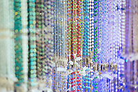 Rosary bead selection in a religious goods store.