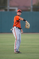AZL Giants Orange left fielder Tyler Flores (26) warms up between innings of an Arizona League game against the AZL Athletics at Lew Wolff Training Complex on June 25, 2018 in Mesa, Arizona. AZL Giants Orange defeated the AZL Athletics 7-5. (Zachary Lucy/Four Seam Images)