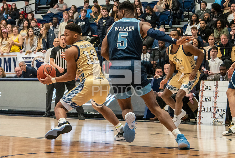WASHINGTON, DC - FEBRUARY 8: Jameer Nelson Jr. #12 of George Washington turns by Antwan Walker #5 of Rhode Island during a game between Rhode Island and George Washington at Charles E Smith Center on February 8, 2020 in Washington, DC.