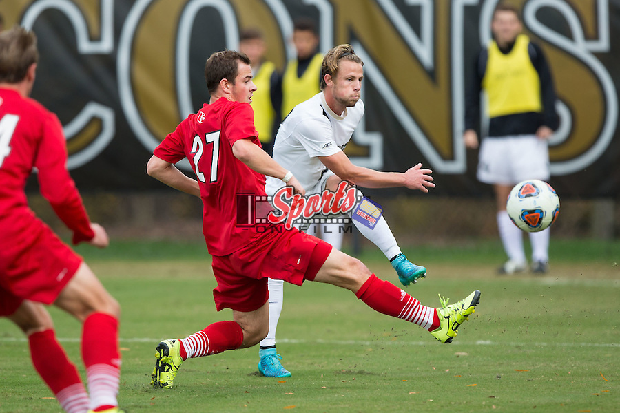 Hayden Partain (21) of the Wake Forest Demon Deacons takes a shot on goal during first half action against the Louisville Cardinals in the quarterfinal round of the 2015 ACC Men's Soccer Championship at Spry Soccer Stadium on November 8, 2015 in Winston-Salem, North Carolina.  The Demon Deacons defeated the Cardinals 2-1 in overtime..  (Brian Westerholt/Sports On Film)
