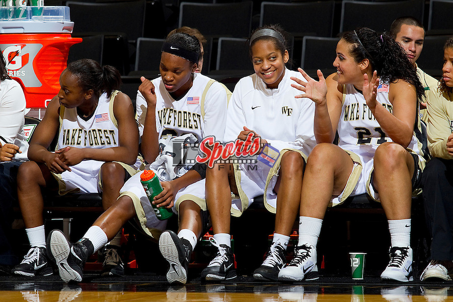 (L-R) Chelsea Douglas #5, Secily Ray #23, Brittany Waters #20 and Sandra Garcia #21 watch the action from the bench late in the second half against the Furman Paladins at the Lawrence Joel Coliseum on December 22, 2010 in Winston-Salem, North Carolina.  The Demon Deacons defeated the Paladins 84-35.  Photo by Brian Westerholt / Sports On Film