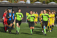 20191026 – Brugge, BELGIUM : referee Chloe Van Mingeroet (M) with assistant referees Joline Delcroix (L) and Shauni Depruyst (R)  pictured entering the pitch with both teams of a women soccer game between Club Brugge Dames and Standard Femina de Liege on the seventh matchday of the Belgian Superleague season 2019-2020 , the Belgian women's football  top division , Saturday 26 th October 2019 at the synthetic terrain 4 at the Jan Breydel site in Brugge  , Belgium  .  PHOTO SPORTPIX.BE | DIRK VUYLSTEKE
