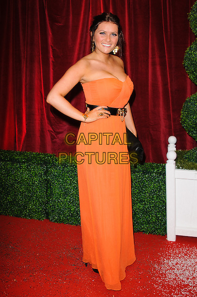 Chelsea Halfpenny.British Soap Awards 2012, The London Television Centre, London, England..28th April 2012.full length orange strapless dress black belt hand on hip.CAP/CJ.©Chris Joseph/Capital Pictures.