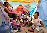 This family is among hundreds of earthquake survivors huddled in tents and makeshift shelters in a soccer stadium in the Santa Teresa area of Petionville, Haiti. They have named the narrow passages between their shelters with street names. Hundreds of thousands of Haitians were left homeless by the January 12 quake.