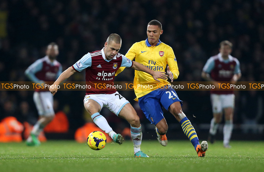 Joe Cole of West Ham and Kieran Gibbs of Arsenal - West Ham United vs Arsenal, Barclays Premier League at Upton Park, West Ham - 26/12/13 - MANDATORY CREDIT: Rob Newell/TGSPHOTO - Self billing applies where appropriate - 0845 094 6026 - contact@tgsphoto.co.uk - NO UNPAID USE