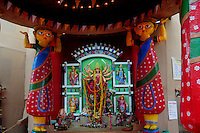 INDIA (West Bengal - Calcutta)  2008, A Durga idol inside a contempurary pandal/altar in Kolkata.  Durga Puja Festival is the biggest festival among bengalies.  As Calcutta is the capital of West Bengal and cultural hub of  the bengali community Durga puja is held with the maximum pomp and vigour. Ritualistic worship, food, drink, new clothes, visiting friends and relatives places and merryment is a part of it. In this festival the hindus worship a ten handed godess riding on a lion armed wth all possible deadly ancient weapons along with her 4 children (Ganesha - God for sucess, Saraswati - Goddess for arts and education, Laxmi - Goddess of wealth and prosperity, Kartikeya - The god of manly hood and beauty). Durga is symbolised as the women power in Indian Mythology.  In Calcutta people from all the religions enjoy these four days of festival in the moth of October. Now the religious festival has become the biggest cultural extravagenza of Calcutta the cultural capital of India. Artistry and craftsmanship can be seen in different sizes and shapes in form of the idol, the interior decor and as well as the pandals erected on the streets, roads and  parks.- Arindam Mukherjee